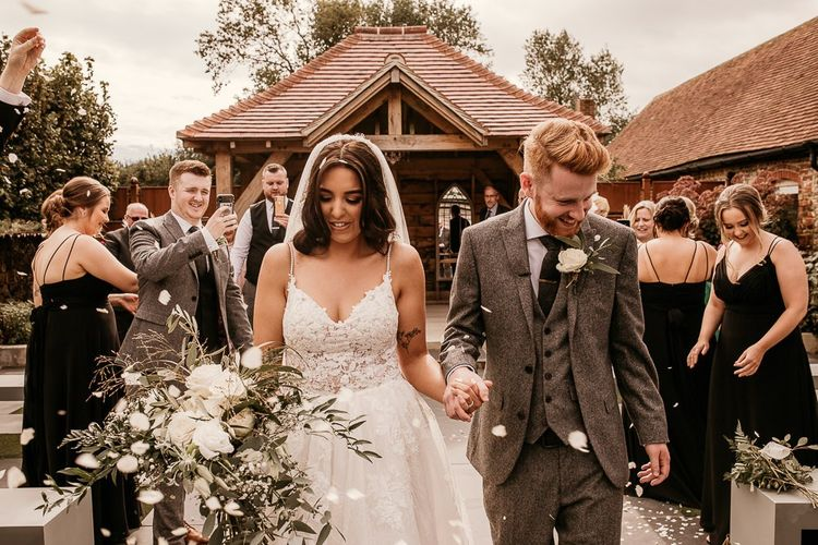 Wedding ceremony confetti exit at Southend Barns with bride in Enzoani wedding dress