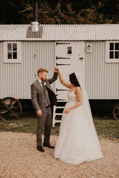 Bride in Enzoani wedding dress and groom in wool suit