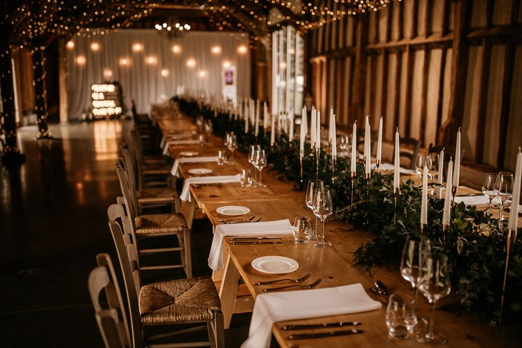 Socially distanced wedding reception at Southend Barns with taper candles