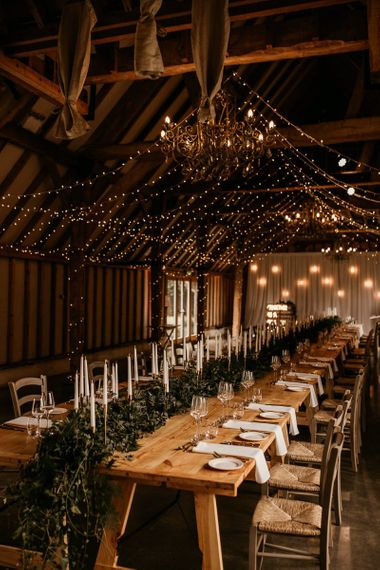 Southend Barns wedding reception with taper candles and fairy lights