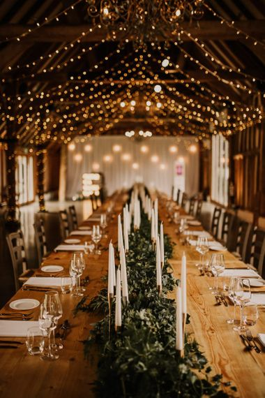 Intimate wedding reception at Southend Barns with rustic decor