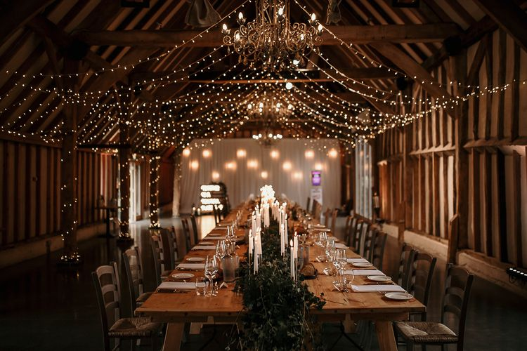 Small wedding reception at Southend Barns with romantic candlelight  and fairy light canopy