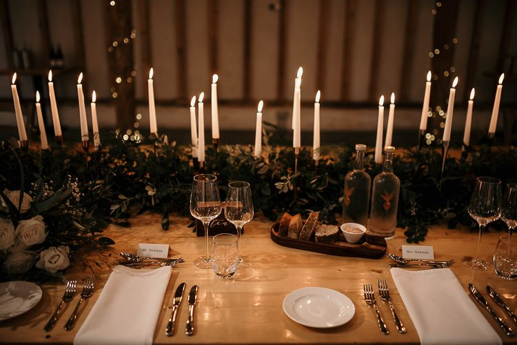 Foliage table runner and taper candles for centrepieces