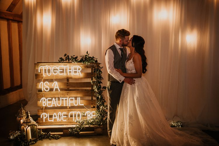Neon wedding sign at rustic wedding