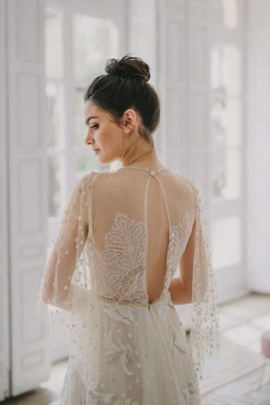 Delicate lace wedding dress with keyhole back detail