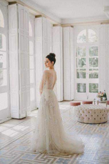 Bride in Marco y María Wedding Dress with Top Knot