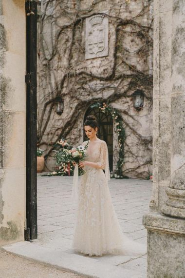 Bride in Lace Wedding Dress Holding Her Anemone Wedding Bouquet