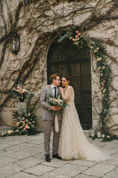 Intimate Bride and Groom Portrait with Bride in Lace Wedding Dress