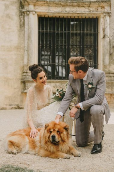 Bride and Groom Portrait with Their Pet Dog