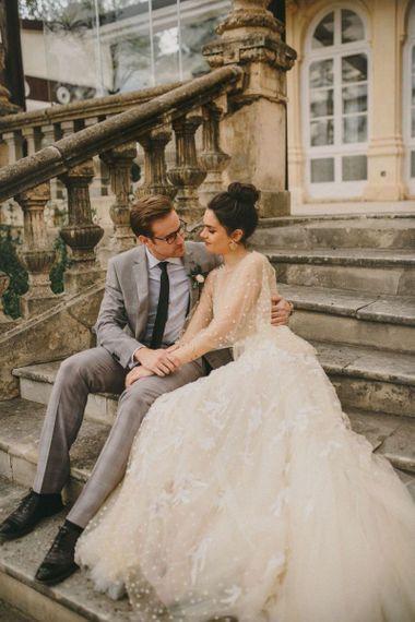 Bride and Groom Embracing on the Steps of Finca Torrefiel Wedding Venue