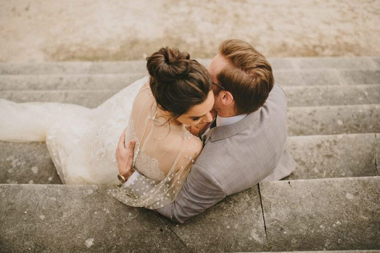 Bride and Groom Embracing on the Steps