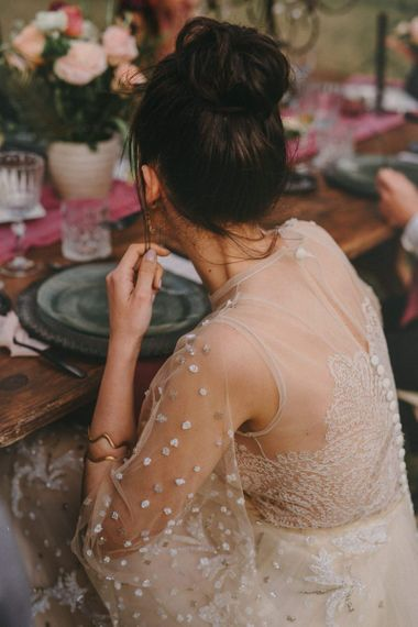Bride in Sheer Wedding Dress with Lace Detail