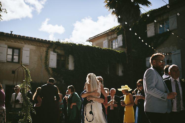 Pastel Outdoor Wedding at Chateau de Lartigolle, France | Lace Caroline Castigliano Bridal Gown | Blush Rewritten Bridesmaid Dresses | Festoon Lights | Nigel John Photography