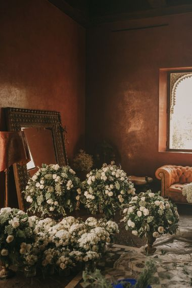 White & Green Wedding Flower Arrangements | Marrakesh Wedding at Ksar Char Bagh Hotel, Planned by Instants Magiques | Pablo Laguia Photography | Monika Frias Videography