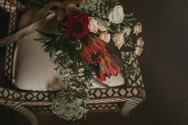 Protea & Rose Bridal Bouquet | Marrakesh Wedding at Ksar Char Bagh Hotel, Planned by Instants Magiques | Pablo Laguia Photography | Monika Frias Videography