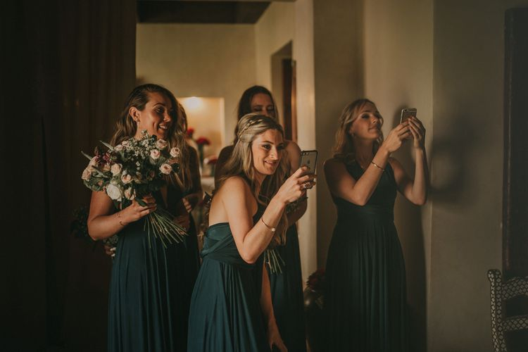 Bridesmaids in Forest Green Multiway Dresses | Marrakesh Wedding at Ksar Char Bagh Hotel, Planned by Instants Magiques | Pablo Laguia Photography | Monika Frias Videography
