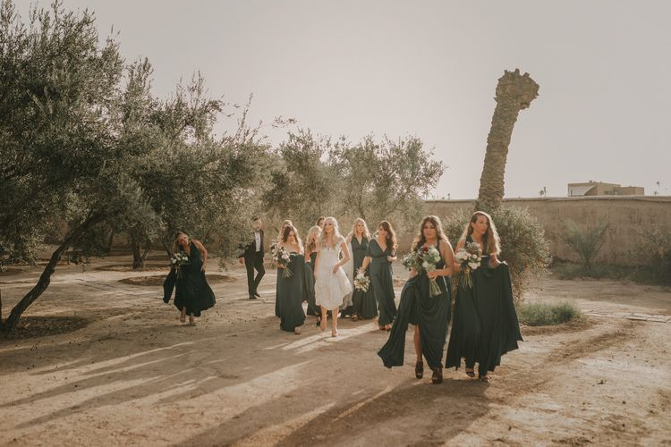 Bridal Party | Bride in  Olvia Lace Gown from TeoKath | Bridesmaids in Forest Green Multiway Dresses | Marrakesh Wedding at Ksar Char Bagh Hotel, Planned by Instants Magiques | Pablo Laguia Photography | Monika Frias Videography