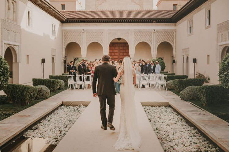 Wedding Ceremony | Bridal Entrance in Olvis Lace Gown from TeoKath Bridal | Marrakesh Wedding at Ksar Char Bagh Hotel, Planned by Instants Magiques | Pablo Laguia Photography | Monika Frias Videography