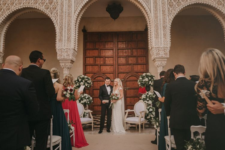 Wedding Ceremony | Bride in Olvis Lace Gown from Teokath Bridal Boutique | Groom in  Zegna Suit | Marrakesh Wedding at Ksar Char Bagh Hotel, Planned by Instants Magiques | Pablo Laguia Photography | Monika Frias Videography