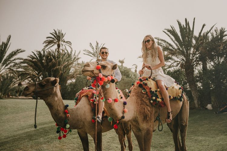 Camel Ride | Marrakesh Wedding at Ksar Char Bagh Hotel, Planned by Instants Magiques | Pablo Laguia Photography | Monika Frias Videography