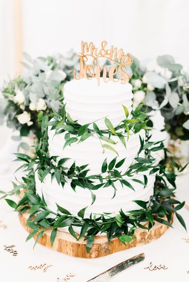 Wedding Cake With White Buttercream And Foliage