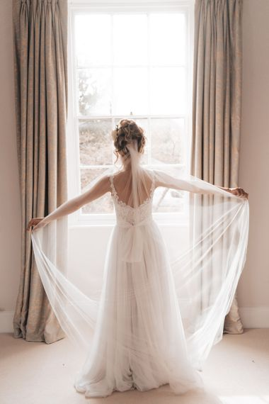 Bride in Stacey by Modeca Wedding Dress with Lace Bodice and Full Skirt