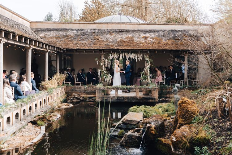 Outdoor Wedding Ceremony with Bride in Stacey by Modeca Wedding Dress and Groom in  Charles Tyrwhitt Suit