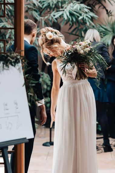 Bride in Stacey by Modeca Wedding Dress Holding Wedding Bouquet