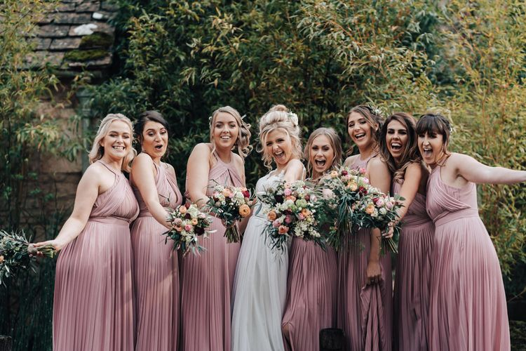 Bridal Party with Bridesmaids in Pink ASOS Dresses and Bride in Stacey by Modeca Wedding Dress