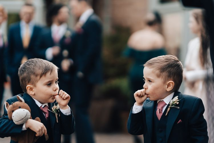Twin Page Boys Sucking Their Thumb