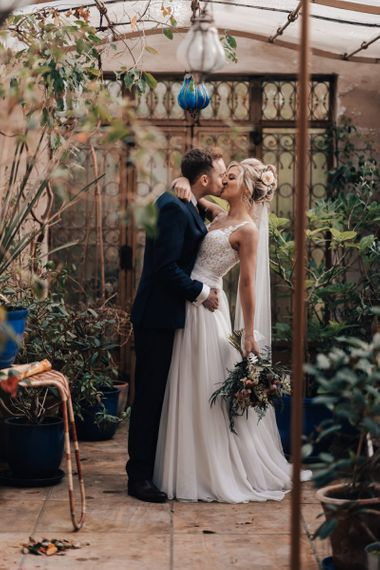 Bride in Stacey by Modeca Wedding Dress and Groom  in Charles Tyrwhitt Suit Embracing