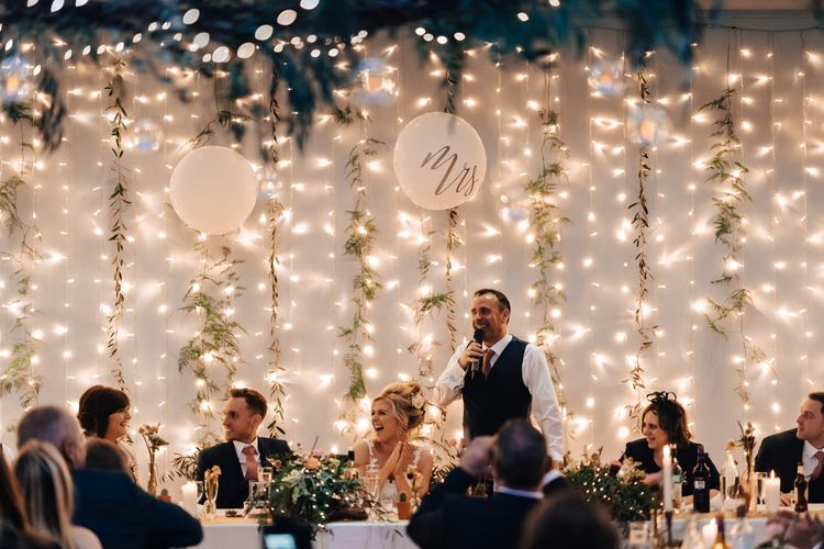 Wedding Reception Speeches at Top Table with Fairy Light Curtain  Backdrop