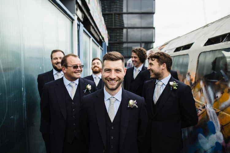 Groom and Groomsmen in Navy Three Piece Suits from Yardsmen | Shoreditch Wedding at Village Underground with Bride in Grace Loves Lace | Chris Barber Photography