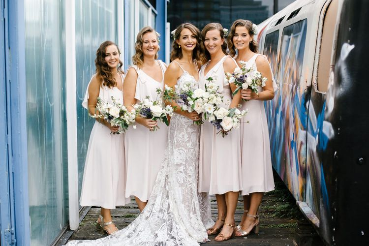 Bride in Grace Loves Lace Gown with Spaghetti Straps and Oversized Rose Embroidery | Blush Pink Coast Bridesmaids Dresses | Bouquets of Roses, Thistles and Foliage | Shoreditch Wedding at Village Underground with Bride in Grace Loves Lace | Chris Barber Photography