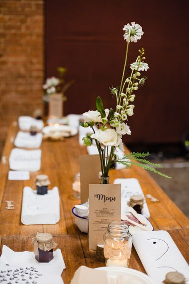 Wedding Reception Decor | Long Wooden Tables | Jam Jar Favours | Boob Bibs | Table Flowers in Milk Bottles | Shoreditch Wedding at Village Underground with Bride in Grace Loves Lace | Chris Barber Photography