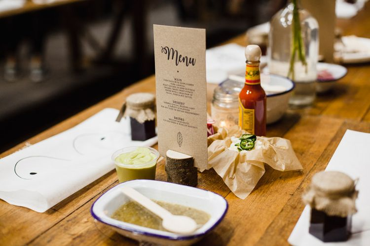Wedding Reception Decor | Long Wooden Tables | Jam Jar Favours | Boob Bibs | Table Flowers in Milk Bottles | Mexican Dips | Shoreditch Wedding at Village Underground with Bride in Grace Loves Lace | Chris Barber Photography