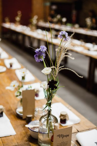 Wedding Reception Decor | Table Flowers in Milk Bottles | Long Wooden Tables | Jam Jar Favours | Shoreditch Wedding at Village Underground with Bride in Grace Loves Lace | Chris Barber Photography