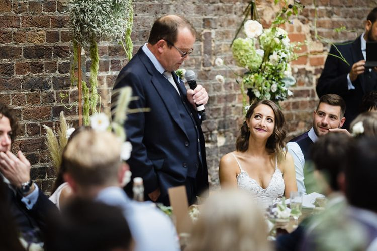 Father of the Bride Speech | Bride in Grace Loves Lace Gown with Spaghetti Straps and Oversized Rose Embroidery | Groom in Navy Three Piece Suit from Yardsmen | Copper Arch With Large Floral Features | Shoreditch Wedding at Village Underground with Bride in Grace Loves Lace | Chris Barber Photography