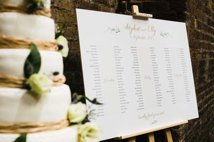 Seating Chart | Six Tier Wedding Cake Decorated with White Roses and Thistles | Shoreditch Wedding at Village Underground with Bride in Grace Loves Lace | Chris Barber Photography