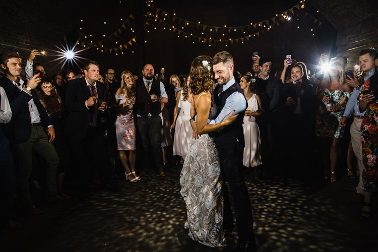 First Dance | Bride in Grace Loves Lace Gown with Spaghetti Straps and Oversized Rose Embroidery | Groom in Navy Three Piece Suit from Yardsmen | Shoreditch Wedding at Village Underground with Bride in Grace Loves Lace | Chris Barber Photography