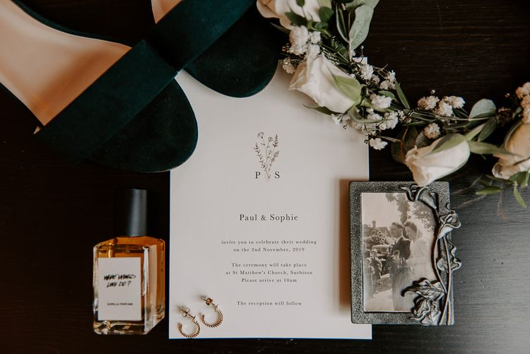 Wedding stationery and white floral crown at intimate celebration