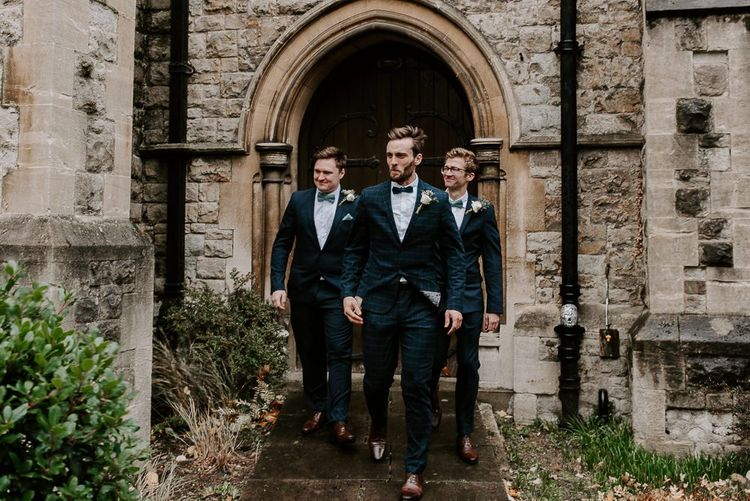 Groom and his groomsmen for intimate church ceremony