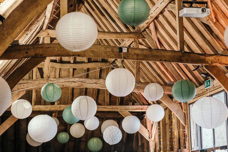 Hanging Paper Lanterns   Gold, Grey & Green Rustic Wedding at The Gilbert White's 16th Century Hampshire Barn   Joasis Photography