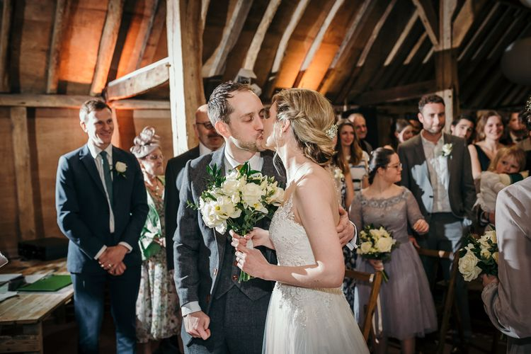 Wedding Ceremony   Bride in Essense of Australia Gown   Groom in  Grey Suit   Gold, Grey & Green Rustic Wedding at The Gilbert White's 16th Century Hampshire Barn   Joasis Photography