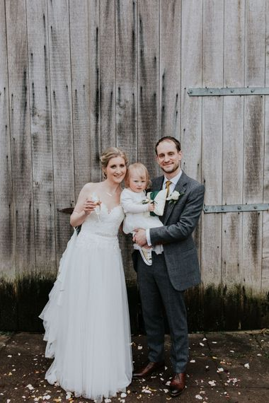 Family Portrait   Bride in Essense of Australia Gown   Groom in  Grey Suit   Gold, Grey & Green Rustic Wedding at The Gilbert White's 16th Century Hampshire Barn   Joasis Photography