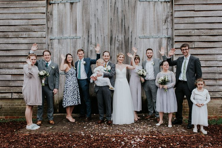 Wedding Party   Bride in Essense of Australia Gown   Groom in  Grey Suit   Gold, Grey & Green Rustic Wedding at The Gilbert White's 16th Century Hampshire Barn   Joasis Photography