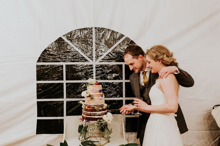 Bride & Groom Cutting the Cake   Gold, Grey & Green Rustic Wedding at The Gilbert White's 16th Century Hampshire Barn   Joasis Photography