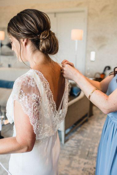 Bride Getting Ready in Charlie Brear Torum Wedding Dress