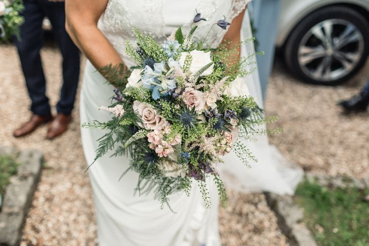 Bride Holding Pastel Pink, White and Blue Hand Tied Wedding Bouquet