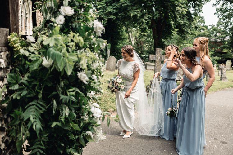 Bride  in Charlie Brear Torum Wedding Dress and Bridesmaids in Blue JJ's House Dresses